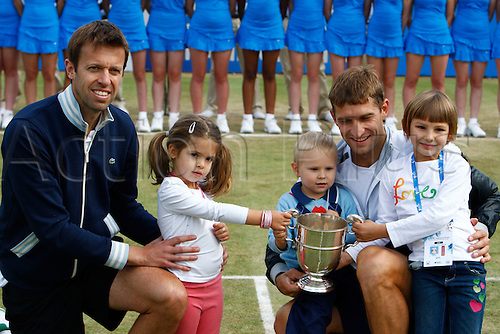 17.06.12 Queens Club, London, ENGLAND: .MIRNYI, Max (BLR)/NESTOR, Daniel (CAN) with they children and  Trophy.mens doubles final round match during MIRNYI, Max (BLR)/NESTOR, Daniel (CAN) versus BRYAN, Bob (USA)/BRYAN, Mike (USA) on day Seven of the Aegon Championships at Queens Club .on June 17, 2012 in London , England.....