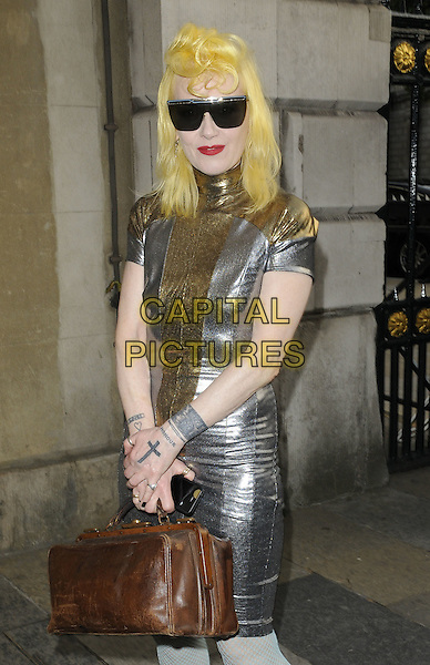 PAM HOGG .attending the Women For Women Gala and awards, Banqueting House, London, England, UK, May 5th 2011..half length dress designer brown bag green blue tights fishnet leather cuff cross on hand tattoo make-up red lipstick dyed yellow hair black sunglasses gold silver smiling beauty .CAP/CAN.©Can Nguyen/Capital Pictures.