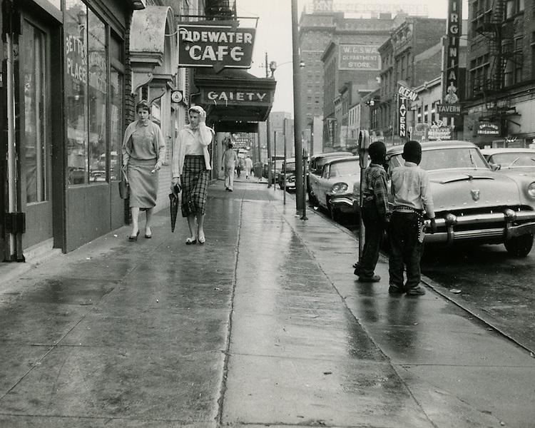 1958 Spring..Redevelopment.Downtown South (R-9)..Main Street looking West..Neal Clark Jr..NEG#.NRHA# 3386..
