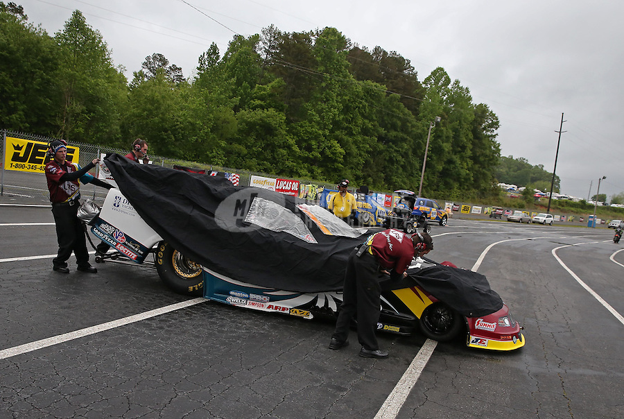 May 3, 2013; Commerce, GA, USA: Crew members push the car of NHRA funny car driver Tim Wilkerson back to the pits during a ran delay to qualifying for the Southern Nationals at Atlanta Dragway. Mandatory Credit: Mark J. Rebilas-