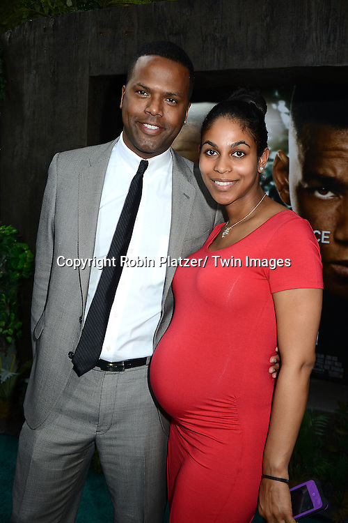 "AJ Calloway and fiancee Dionne Walker attends the Domestic Premiere of ""After Earth""  on May 29, 2013 at the Ziegfeld Theatre in New York City."