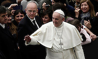 Papa Francesco saluta i fedeli al suo arrivo all'udienza generale del mercoledi' in aula Paolo VI, Citta' del Vaticano, 7 dicembre 2016.<br /> Pope Francis waves faithful as he arrives to lead  his weekly general audience in Paul VI Hall at the Vatican on December 7, 2016. <br /> UPDATE IMAGES PRESS/Isabella Bonotto<br /> <br /> STRICTLY ONLY FOR EDITORIAL USE