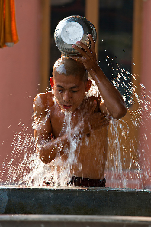 Buddhist monks bathing in the morning at the buddhist temple in Mandalay
