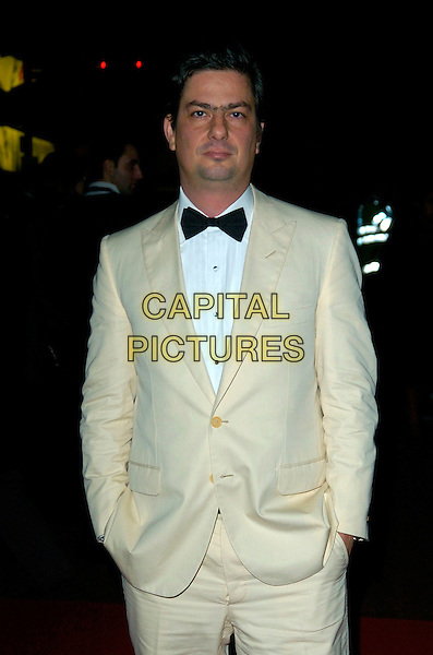 """ROMAN COPPOLA.""""The Darjeeling Limited""""  BFI London Film Festival closing gala, Odeon Leicester Square, London, England..November 1st, 2007.LFF half length beige cream suit hands in pocket black bow tie .CAP/CAN.©Can Nguyen/Capital Pictures"""