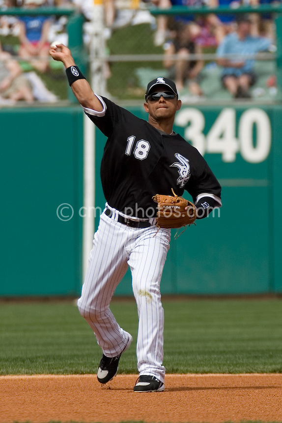 Mar 15, 2008; Tucson, AZ, USA; Chicago White Sox shortstop Orlando Cabrera (18) throws a ball to first in front of a sell-out crowd at Tucson Electric Park.  The White Sox won 5-3.