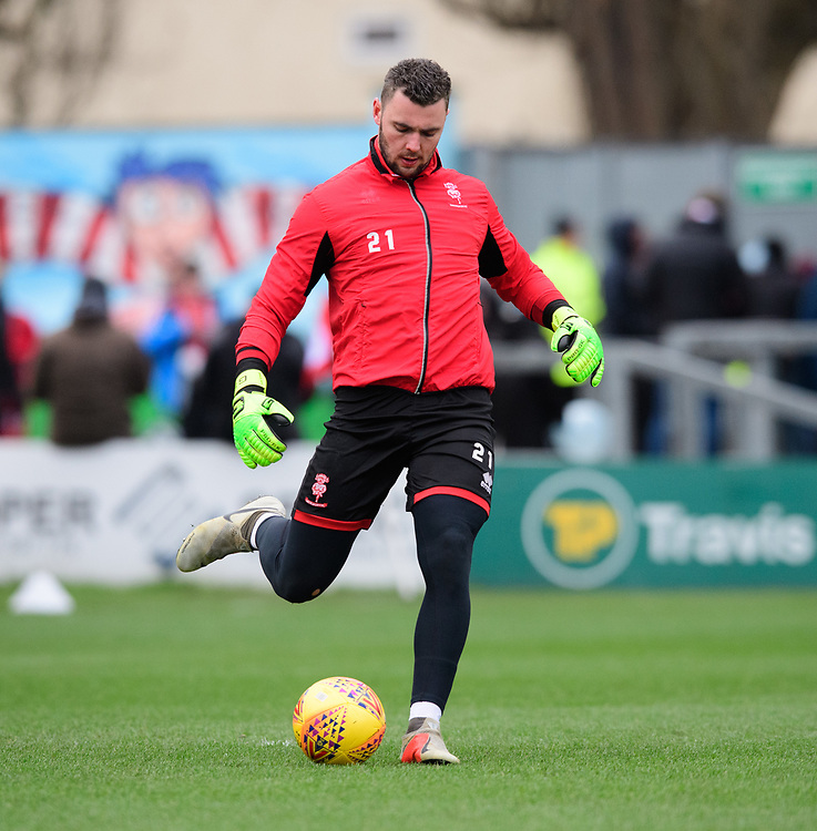 Lincoln City's Grant Smith during the pre-match warm-up<br /> <br /> Photographer Chris Vaughan/CameraSport<br /> <br /> The EFL Sky Bet League Two - Lincoln City v Grimsby Town - Saturday 19 January 2019 - Sincil Bank - Lincoln<br /> <br /> World Copyright &copy; 2019 CameraSport. All rights reserved. 43 Linden Ave. Countesthorpe. Leicester. England. LE8 5PG - Tel: +44 (0) 116 277 4147 - admin@camerasport.com - www.camerasport.com