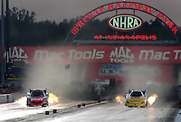 Sept. 4, 2010; Clermont, IN, USA; NHRA funny car driver Cruz Pedregon (left) races alongside Bob Bode during qualifying for the U.S. Nationals at O'Reilly Raceway Park at Indianapolis. Mandatory Credit: Mark J. Rebilas-
