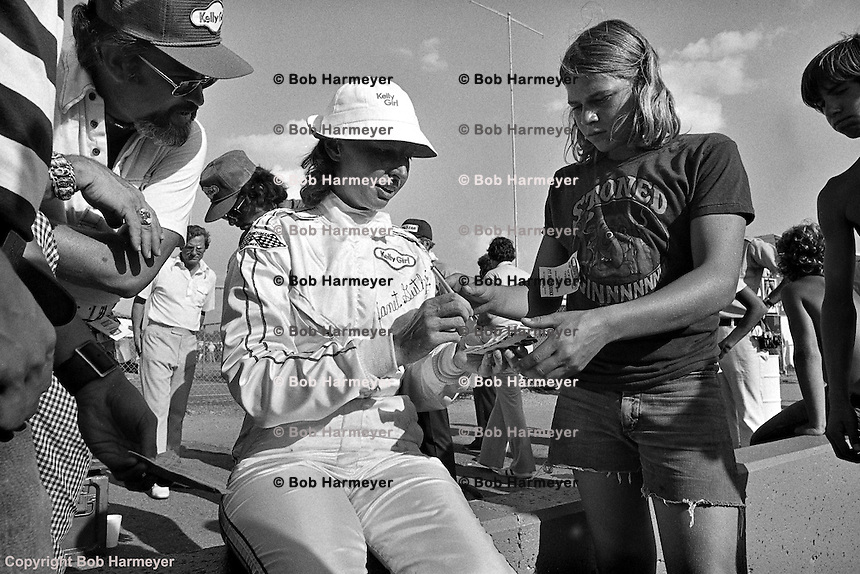 Janet Guthrie signs autographs after a 1976 USAC Champ Car race at Michigan International Speedway near Brooklyn, Michigan, USA.