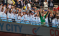 Jordan Willis of Coventry City lifts the Trophy as the team celebrate during the The Checkatrade Trophy / EFL Trophy FINAL match between Oxford United and Coventry City at Wembley Stadium, London, England on 2 April 2017. Photo by Andy Rowland.