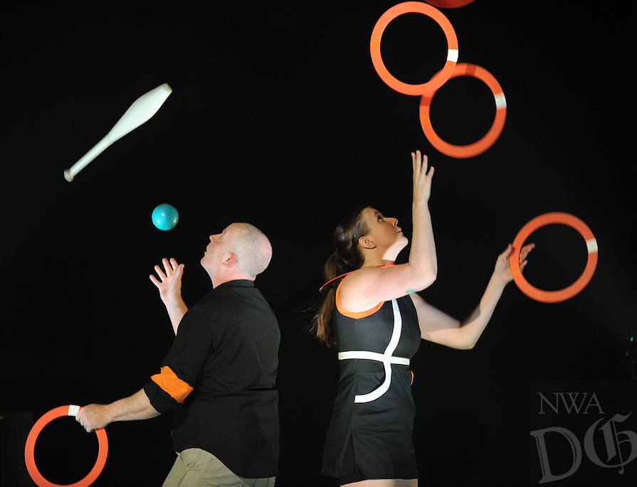 NWA Democrat-Gazette/ANDY SHUPE<br /> Galen Harp, left, and Ellen Winters of Institute of Jugglology perform Thursday, Dec. 31, 2015, during the fifth annual Last Night Fayetteville celebration on the town's square. The celebration featured music and performances for all ages on 11 stages leading up to the Hog Drop and fireworks at midnight. Visit nwadg.com/photos to see more photographs from the event.