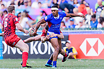 Tomasi Alosio of Samoa (L) is tackled by the Wales defence during the HSBC Hong Kong Sevens 2018 Shield Final match between Samoa and Wales on April 8, 2018 in Hong Kong, Hong Kong. Photo by Marcio Rodrigo Machado / Power Sport Images