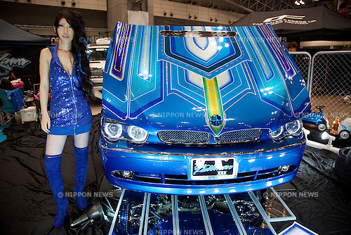 """April 21, 2013, Chiba, Japan - A Go-Go dancer poses for the camera next to a customer car. The """"New Style Custom Autoshow NEXT 2013"""" for 5th time comes to Makuhari Messe to show luxury custom cars (Lamborghini, Maserati, Cadillac, Honda, Chevrolet, etc) which compete in 16 different """"New Style"""" categories. The exhibition brings beautiful Go-Go dancers who perform on the stage and pose for the cameras of visitors. The car show brings the ultimate of technology in illumination, audio and video system; car accessories, rims and new designs on chassis, everything to custom luxury cars. (Photo by Rodrigo Reyes Marin/AFLO).."""