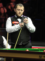 Mark Allen lines up his next shot during the Dafabet Masters Quarter Final 1 match between Mark Allen and Barry Hawkins at Alexandra Palace, London, England on 14 January 2016. Photo by Liam Smith / PRiME Media Images