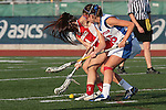 Placentia, CA 05/14/10 - Tully Tampakes (Redondo #4) and Michelle Woyshner (Los Alamitos # 6) in action during the 2010 CIF Girls Lacrosse Championship game between Redondo Union and Los Alamitos, Los Alamitos defeated Redondo 24-7.