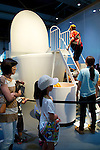 """A boy slides down the giant toilet at the Toilet!? Human Waste & Earth's Future exposition on August 1, 2014 in Tokyo, Japan. The Toilet!? Human Waste & Earth's Future is an exposition to listen the toilet's voice and explore what is the """"happy toilet"""" for each human being on the earth at National Museum of Emerging Science and Innovation in Tokyo from July 2 to October 5. The toilet is related not only to our daily life but also to the global environment. The exposition consist of eight areas where you can learn toilet problems for each generation and in the world. (Photo by Rodrigo Reyes Marin/AFLO)"""