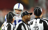Sept. 27, 2009; Glendale, AZ, USA; Indianapolis Colts quarterback Peyton Manning argues with the referees in the second half against the Arizona Cardinals at University of Phoenix Stadium. Indianapolis defeated Arizona 31-10. Mandatory Credit: Mark J. Rebilas-