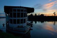 East Sepik Province. Sepik Spirit river cruise vessel at the confluence of Korosameri and Karawari River at sunrise.