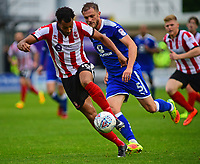 Lincoln City's Matt Green vies for possession with Chesterfield's Scott Wiseman<br /> <br /> Photographer Andrew Vaughan/CameraSport<br /> <br /> The EFL Sky Bet League Two - Lincoln City v Chesterfield - Saturday 7th October 2017 - Sincil Bank - Lincoln<br /> <br /> World Copyright &copy; 2017 CameraSport. All rights reserved. 43 Linden Ave. Countesthorpe. Leicester. England. LE8 5PG - Tel: +44 (0) 116 277 4147 - admin@camerasport.com - www.camerasport.com