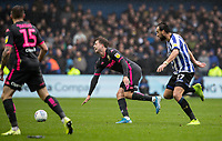 Leeds United's Patrick Bamford (centre) is caught by Sheffield Wednesday's Atdhe Nuhiu (right) <br /> <br /> Photographer Andrew Kearns/CameraSport<br /> <br /> The EFL Sky Bet Championship - Sheffield Wednesday v Leeds United - Saturday 26th October 2019 - Hillsborough - Sheffield<br /> <br /> World Copyright © 2019 CameraSport. All rights reserved. 43 Linden Ave. Countesthorpe. Leicester. England. LE8 5PG - Tel: +44 (0) 116 277 4147 - admin@camerasport.com - www.camerasport.com