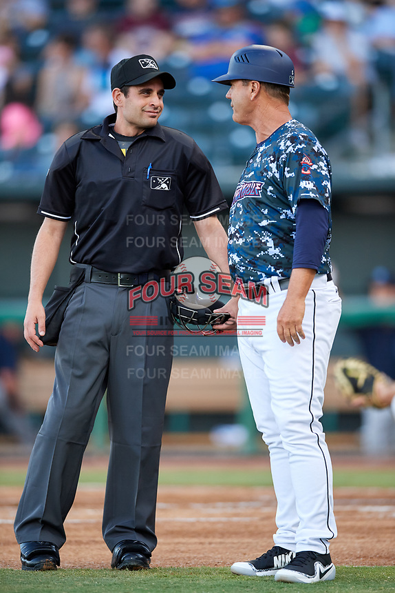 Jacksonville Jumbo Shrimp manager Randy Ready (5) talks with home plate umpire Anthony Perez during a game against the Mobile BayBears on April 14, 2018 at Baseball Grounds of Jacksonville in Jacksonville, Florida.  Mobile defeated Jacksonville 13-3.  (Mike Janes/Four Seam Images)