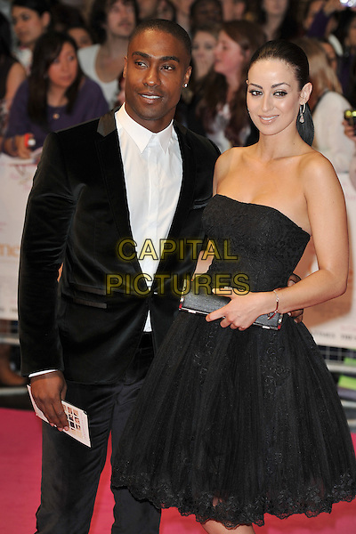 "SIMON WEBBE & MARIA KOUKA.""One Day"" UK premiere, Vue Westfield cinema, Westfield Shopping Centre, London, England..August 23rd, 2011.half length black dress strapless suit white shirt couple clutch bag.CAP/MAR.© Martin Harris/Capital Pictures."