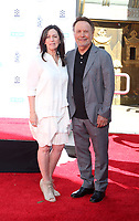 HOLLYWOOD, CA - APRIL 12: Janice Crystal, Billy Crystal, at 2019 10th Annual TCM Classic Film Festival - Hand and Footprint Ceremony: Billy Crystal at the TCL Chinese Theatre IMAX on April 12, 2019. <br /> CAP/MPI/FS<br /> ©FS/MPI/Capital Pictures