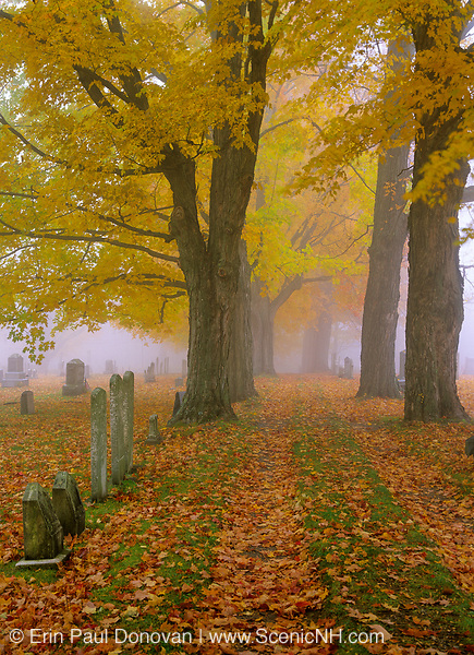 Entrance into Greenlawn Cemetery during foggy autumn day in Mount Vernon, New Hampshire USA.