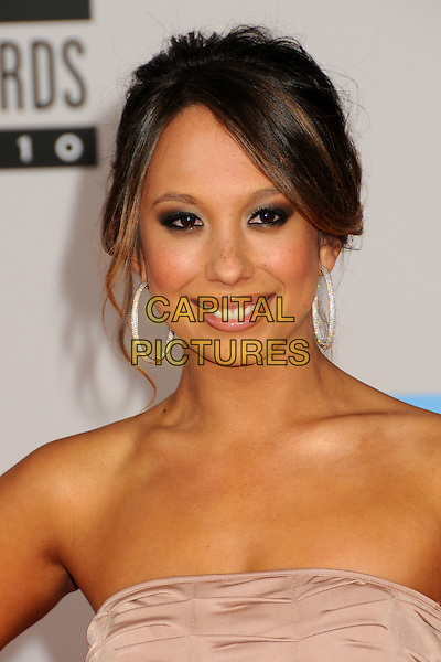 CHERYL BURKE.2010 American Music Awards - Arrivals held at Nokia Theatre L.A. Live, Los Angeles, California, USA..November 21st, 2010.amas ama headshot portrait hoop earrings blue eyeshadow make-up lipstick beauty strapless.CAP/ADM/BP.©Byron Purvis/AdMedia/Capital Pictures.