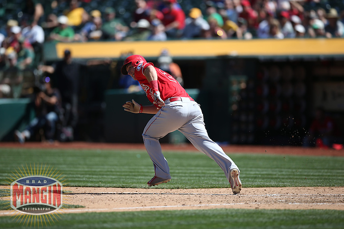 OAKLAND, CA - APRIL 30:  Mike Trout #27 of the Los Angeles Angels bats against the Oakland Athletics during the game at O.co Coliseum on Thursday, April 30, 2015 in Oakland, California. Photo by Brad Mangin