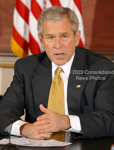 Washington, D.C. - March 22, 2007 -- United States President George W. Bush participates in a Roundtable with the Iraq Provincial Reconstruction Team (PRT) Leaders.  The President also announced the United States Secretary of State Condoleezza Rice would be returning to the Middle East to continue the administration's efforts to broker a peace agreement in the region. PRTs are joint civilian-military units that support local leaders and empower provincial authorities by working closely with the communities they serve.  The expansion is a joint Department of State-Department of Defense mission that will employ both civilian and military resources toward a common strategic plan.  <br /> Credit: Ron Sachs - Pool