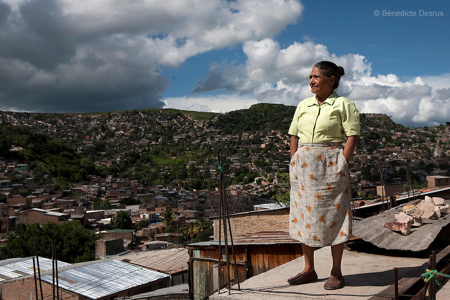 8 July 2009 - Tegucigalpa, Honduras  A supporter of ousted Honduran President Manuel Zelaya stands on the roof of her house in Tegucigalpa, capital of Honduras. Photo credit: Benedicte Desrus