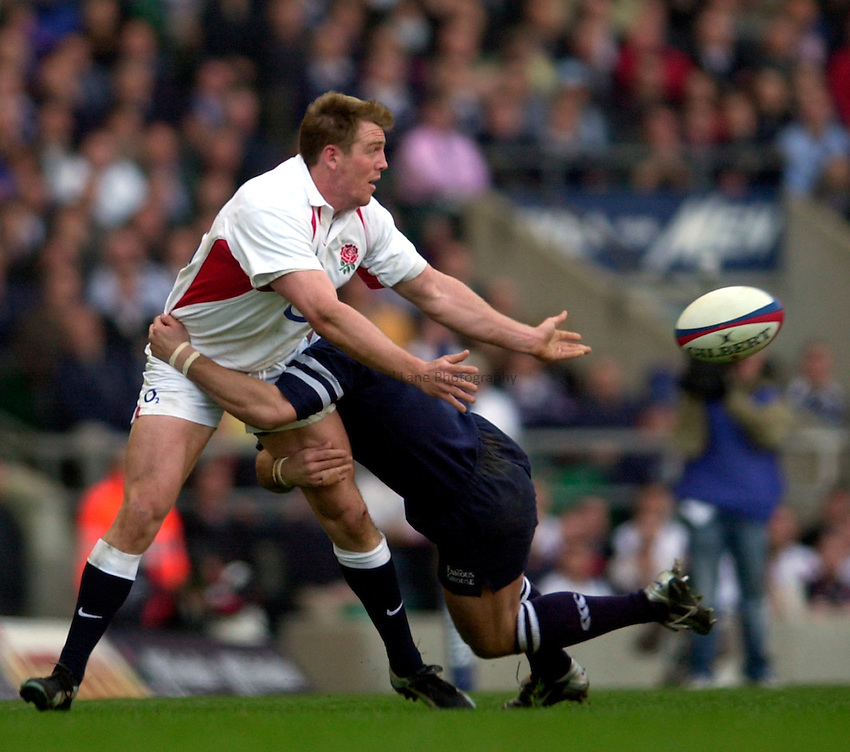 Photo. Richard Lane.England v Scotland. RBS Six Nations Chamionship. 22/03/2003.Mike Tindall gets the ball away.