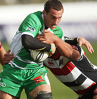 Manawatu's Aaron Cruden looks for support in the tackle during the Air NZ Cup rugby match between Manawatu Turbos and Counties-Manukau Steelers at FMG Stadium, Palmerston North, New Zealand on Sunday, 2 August 2009. Photo: Dave Lintott / lintottphoto.co.nz