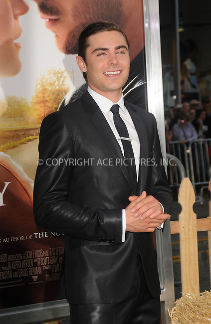 WWW.ACEPIXS.COM . . . . .  ....April 16 2012, LA....Zac Efron arriving at the premiere  of  'The Lucky One' at Grauman's Chinese Theatre on April 16, 2012 in Hollywood, California....Please byline: PETER WEST - ACE PICTURES.... *** ***..Ace Pictures, Inc:  ..Philip Vaughan (212) 243-8787 or (646) 769 0430..e-mail: info@acepixs.com..web: http://www.acepixs.com