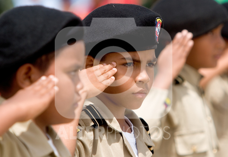 "Venezuelan military school boys march during a military parade in Valencia, Venezuela, on Saturday, June 24, 2006. The military parade was to celebrate Army Day and took place in ""Campo de Carabobo"", the field where the last big battle for the Venezuelan independence was won. (ALTERPHOTOS/Alvaro Hernandez)."
