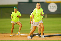 The grounds crew does a little dance while dragging the infield between innings of the Coastal Plain League game between the Thomasville HiToms and the Gastonia Grizzlies at Sims Legion Park on June 2, 2011 in Gastonia, North Carolina.  The Hi-Toms defeated the Grizzlies 9-4.  Photo by Brian Westerholt / Four Seam Images