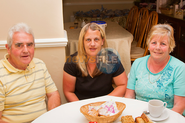 James O'Neill, Fidelma Cooney and Pauline O'Neill at the Coffee Morning in aid of the Drogheda Alzheimer's Group..Picture: Shane Maguire / www.newsfile.ie.
