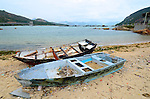 Abandoned fishing boats lie on the beach of Lamma Island on the south of Hong Kong.