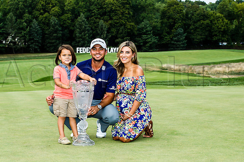 August 30, 2015: Jason Day pose with with his wife Ellie and son Dash after winning The Barclays with a score of 19 under at Plainfield Country Club in Edison, NJ.