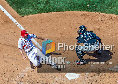 9 July 2017: Washington Nationals All-Star second baseman Daniel Murphy slides home safely to score Washington's 6th run in the 5th inning against the Atlanta Braves at Nationals Park in Washington, DC. The Nationals defeated the Atlanta Braves to split their 4-game series going into the All-Star break. Mandatory Credit: Ed Wolfstein Photo *** RAW (NEF) Image File Available ***