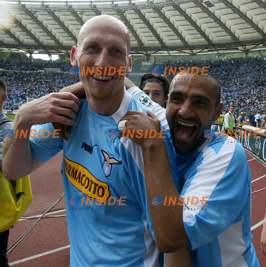 Roma 16/5/2004 Lazio Modena 2-1 Campionato Italiano Serie A 2003/2004 <br /> Jaap Stam and Fabio Liverani<br /> La Lazio festeggia, al termine della partita, la conquista della Coppa Italia avvenuta Mercoledi 12/5/2004 a Torino contro la Juventus. <br /> Lazio team celebrates, at the end of the championship match, Italy cup victory obtained on Wednesday, May 15 2004 against Juventus.  <br /> Photo Andrea Staccioli Insidefoto