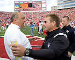 MADISON, WI - OCTOBER 23: Head coach Barry Alvarez (L) of the Wisconsin Badgers and head coach Randy Walker of the Northwestern Wildcats shake hands after the game at Camp Randall Stadium on October 23, 2004 in Madison, Wisconsin. Wisconsin beat Northwestern 24-12. (Photo by David Stluka