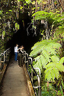 Woman visitors entering Thurston Lava Tube ( Nahuku ), Hawaii Volcanoes National Park, Kilauea, Big Island, Hawaii
