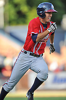 Rome Braves second baseman Eric Garcia #8 runs to first during a game against the Asheville Tourists at McCormick Field on July 25, 2013 in Asheville, North Carolina. The Tourists won the game 9-6. (Tony Farlow/Four Seam Images)