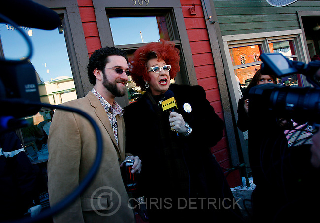 Park City, UT--1/21/07--2:29:51 PM--.Dustin Diamond, left, and Zannel's Ester Goldberg film on Main Street, with the goal of getting schwag for shops in Park City....*****************.Sundance '07: Sunday.. Chris Detrick/Salt Lake Tribune.File #_1CD5833....`