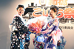 July 27 2012, Tokyo, Japan  The winner Shoko Kondo receives flowers from the last year winner at Yukata Beauty Contest in Koichi Festival. Shoko Kondo, one of the 10 finalists of 270 candidates, wins the annual Yukata Beauty Festival at Koichi Festival in Shimbashi, Tokyo. (Photo by Rodrigo Reyes Marin/AFLO)..