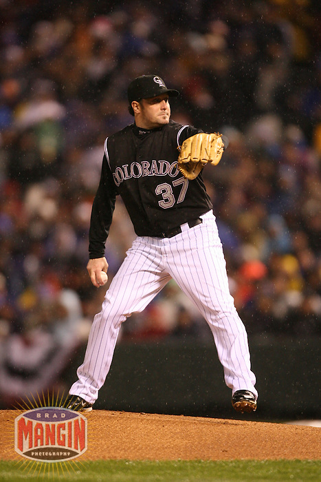 DENVER, CO - Josh Fogg of the Colorado Rockies pitches as the rain falls in Game 3 of the National League Championship Series against the Arizona Diamondbacks at Coors Field in Denver, Colorado on October 14, 2007. Photo by Brad Mangin