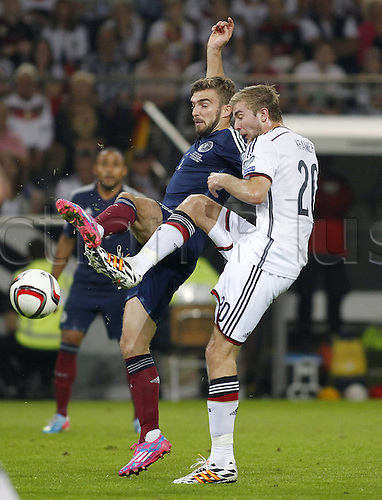 07.09.2014. Dortmund, Germany.   international match Germany Scotland  in Signal Iduna Park in Dortmund.  Scotlands James Morrison (L) against Germanys Christoph Kramer