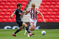 27th June 2020; Bet365 Stadium, Stoke, Staffordshire, England; English Championship Football, Stoke City versus Middlesbrough; Badou Ndiaye of Stoke City is tackled by Jonny Howson of Middlesbrough