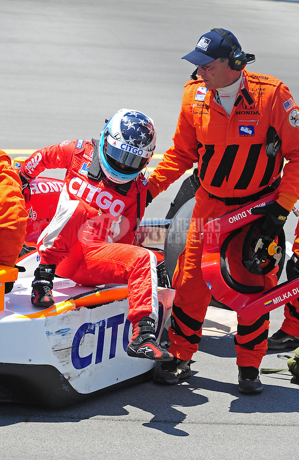 Jun. 20, 2008; Newton, IA, USA; IRL driver Milka Duno (left) is helped from her car after crashing during practice for the Iowa Corn Indy 250 at the Iowa Speedway. Mandatory Credit: Mark J. Rebilas-